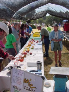 Visitors sampling heirloom tomatoes and garlic